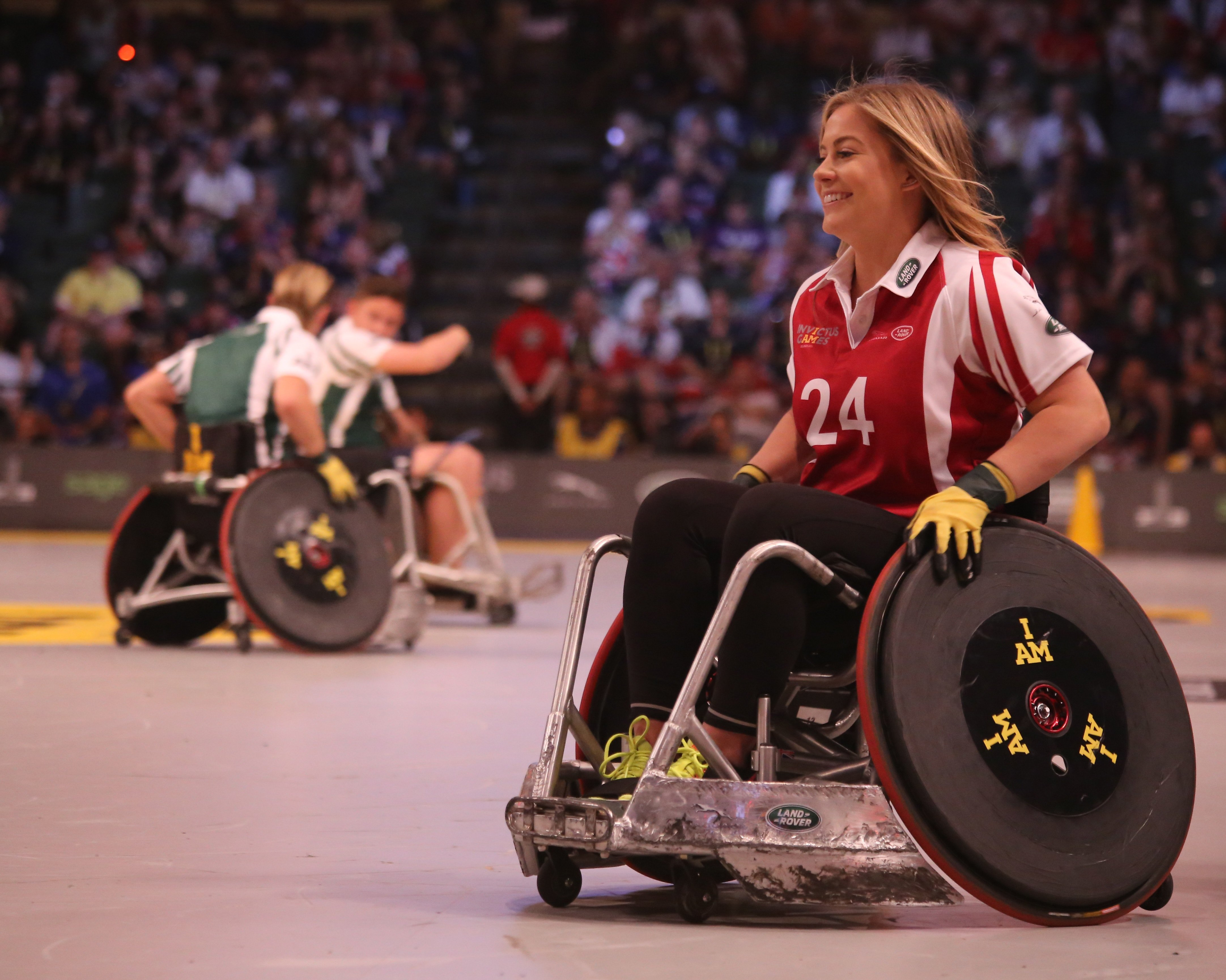 An athlete plays an adaptive sport while using her wheelchair.