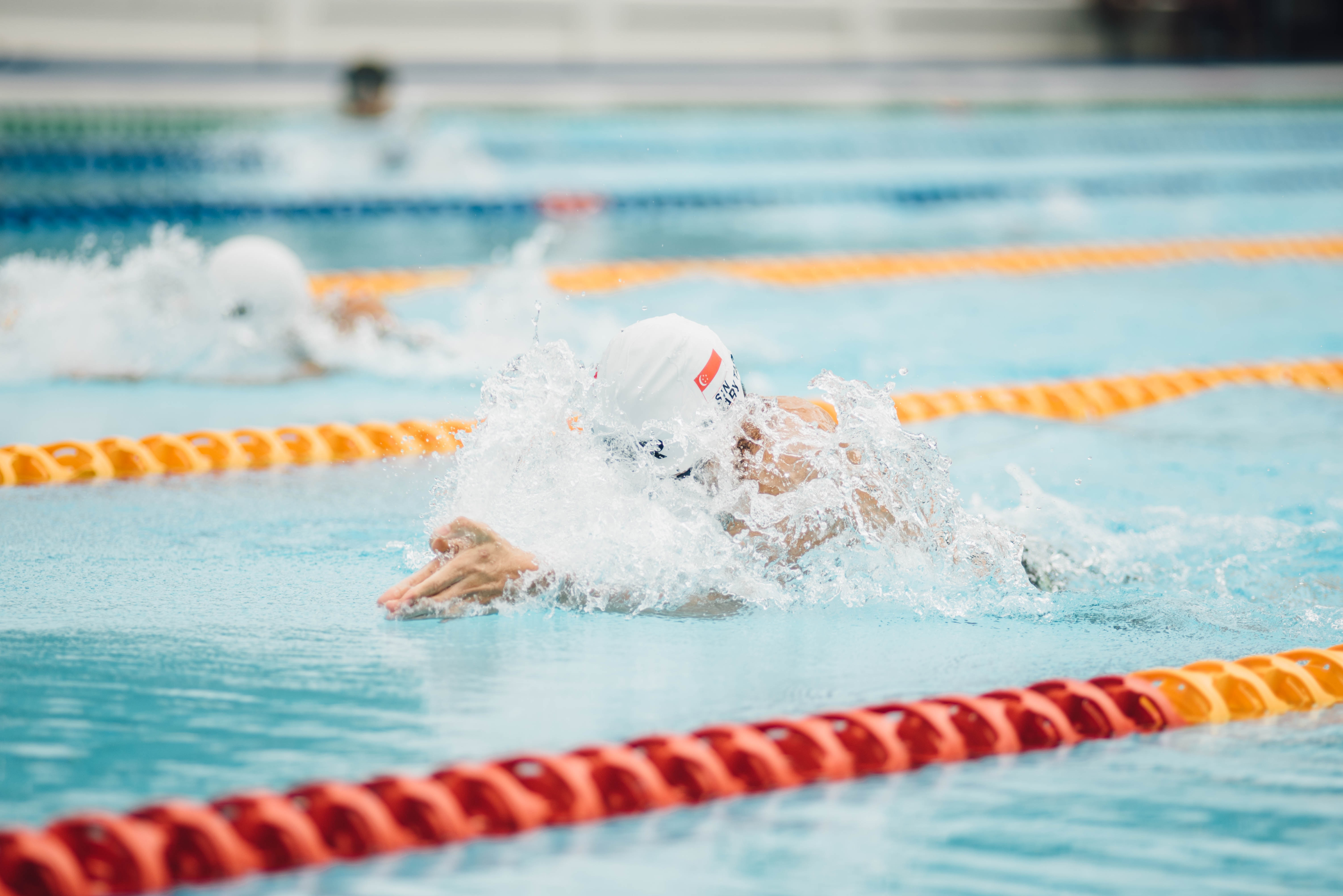 Athletes with disabilities compete in a swimming competition.