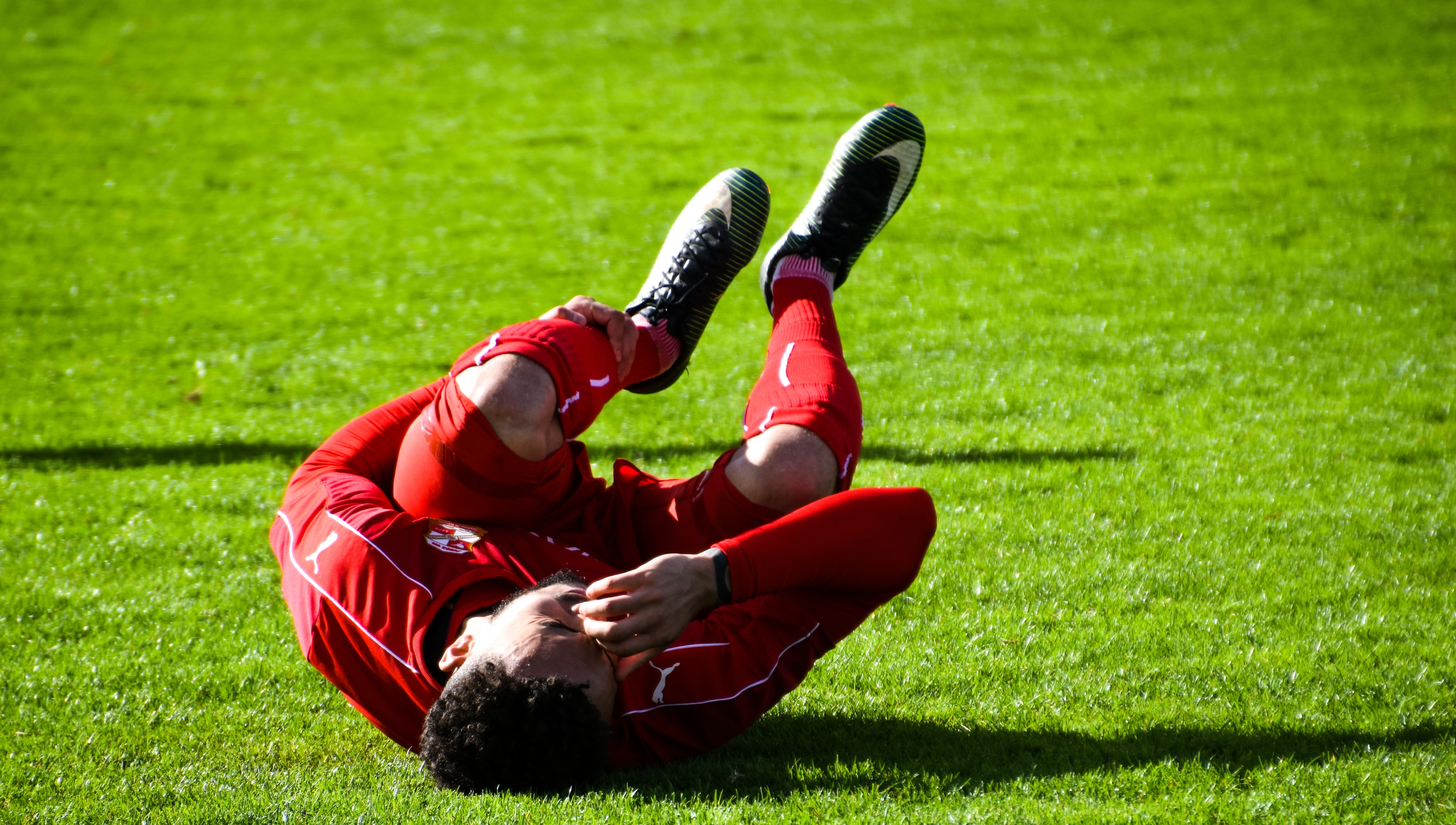 An athlete lays on the field after sustaining a head injury