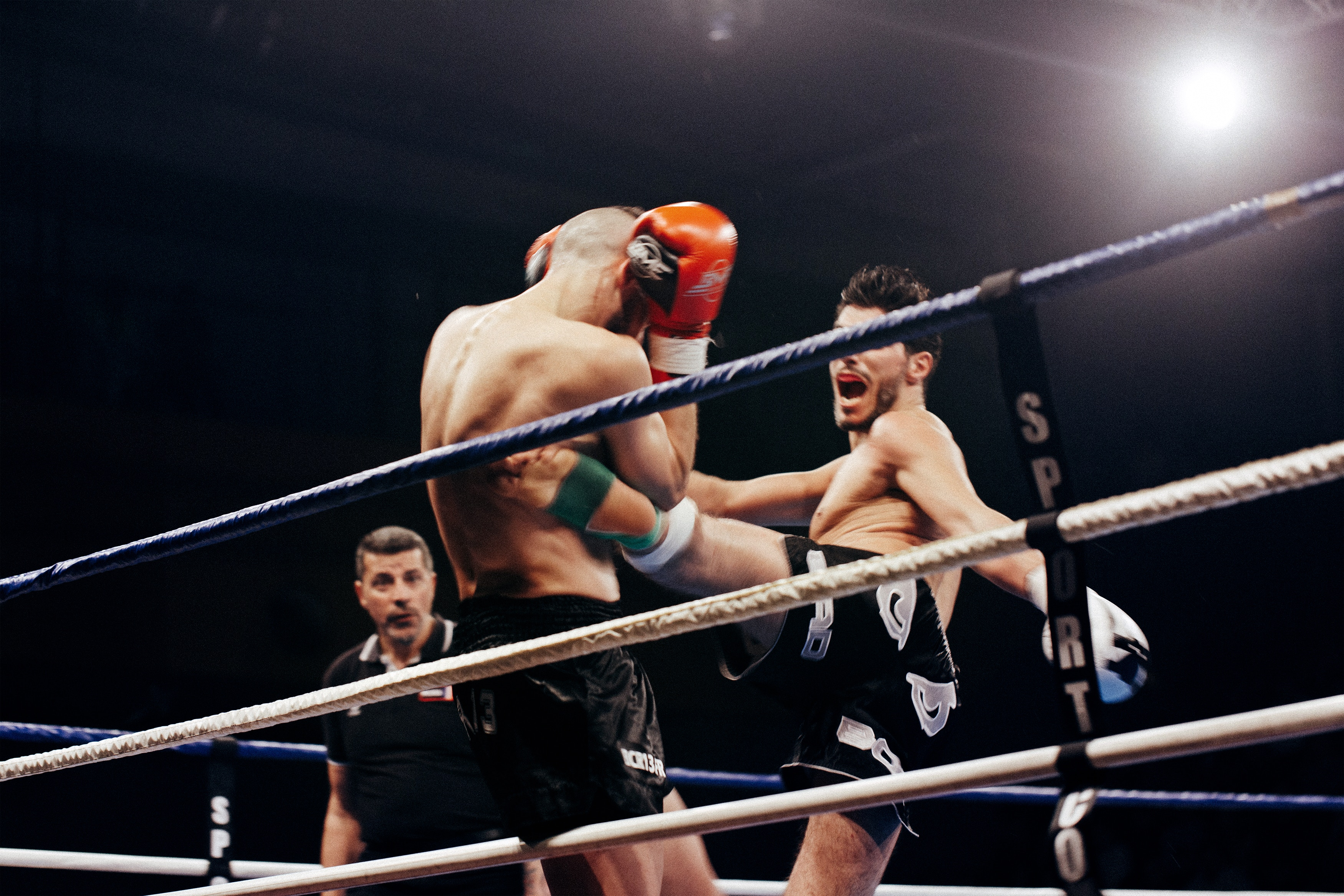 A boxer protects his head to prevent a concussion during a fight