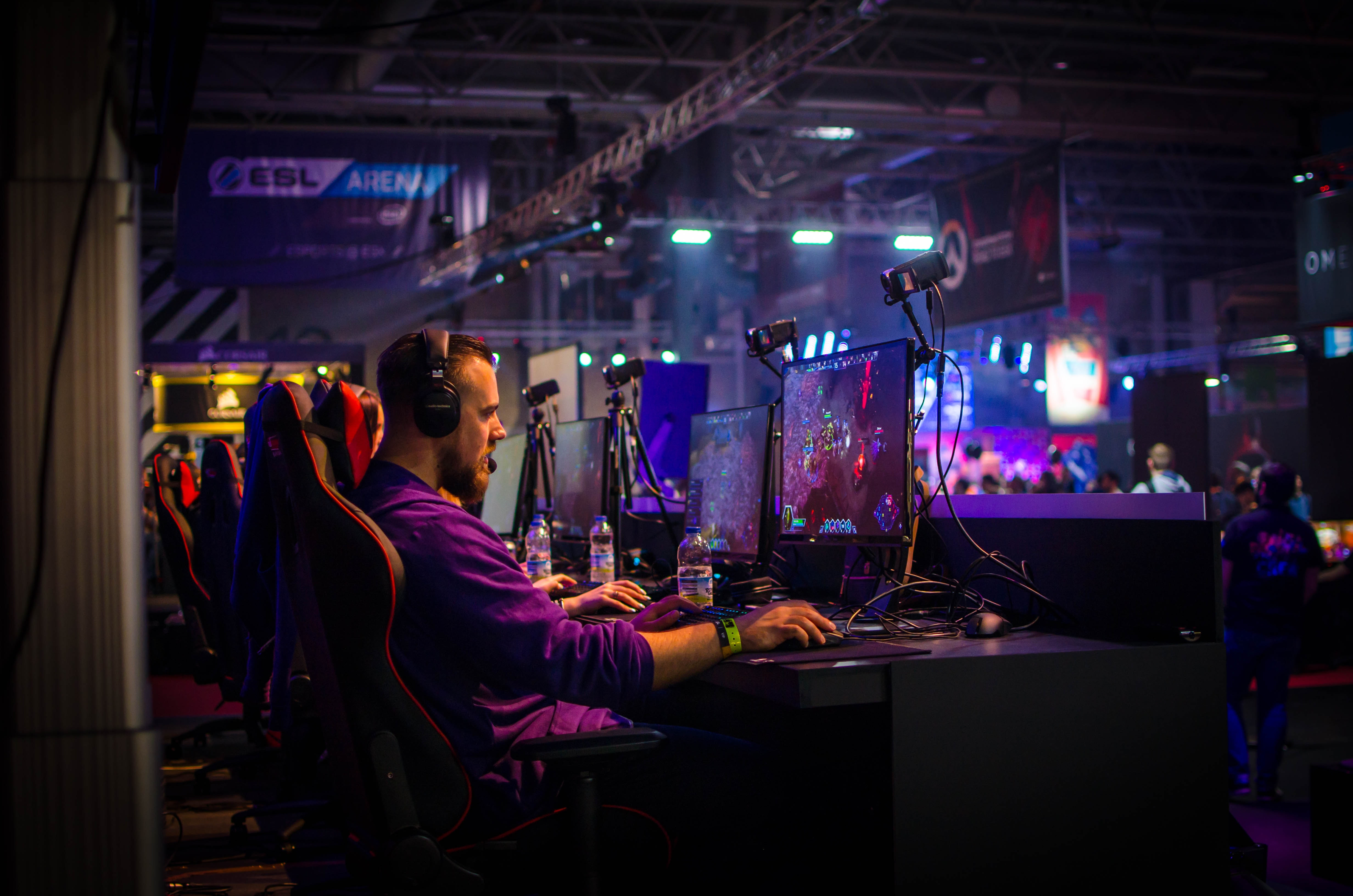 An e-athlete competes in an esports tournament held at a dedicated esports arena