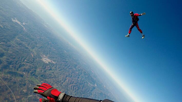Extreme athlete engage in skydiving