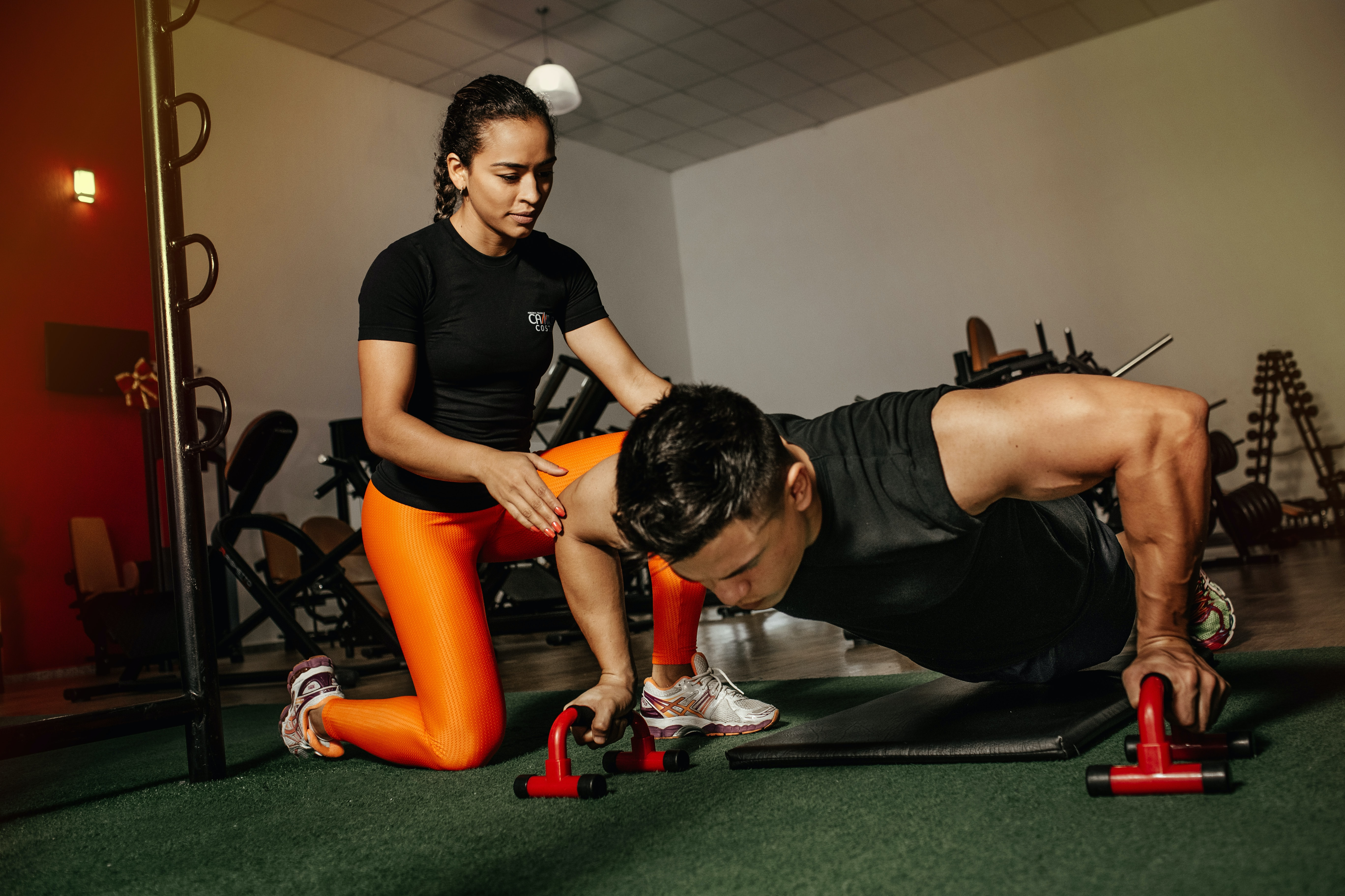 A mental performance coach helping her client who's an athlete
