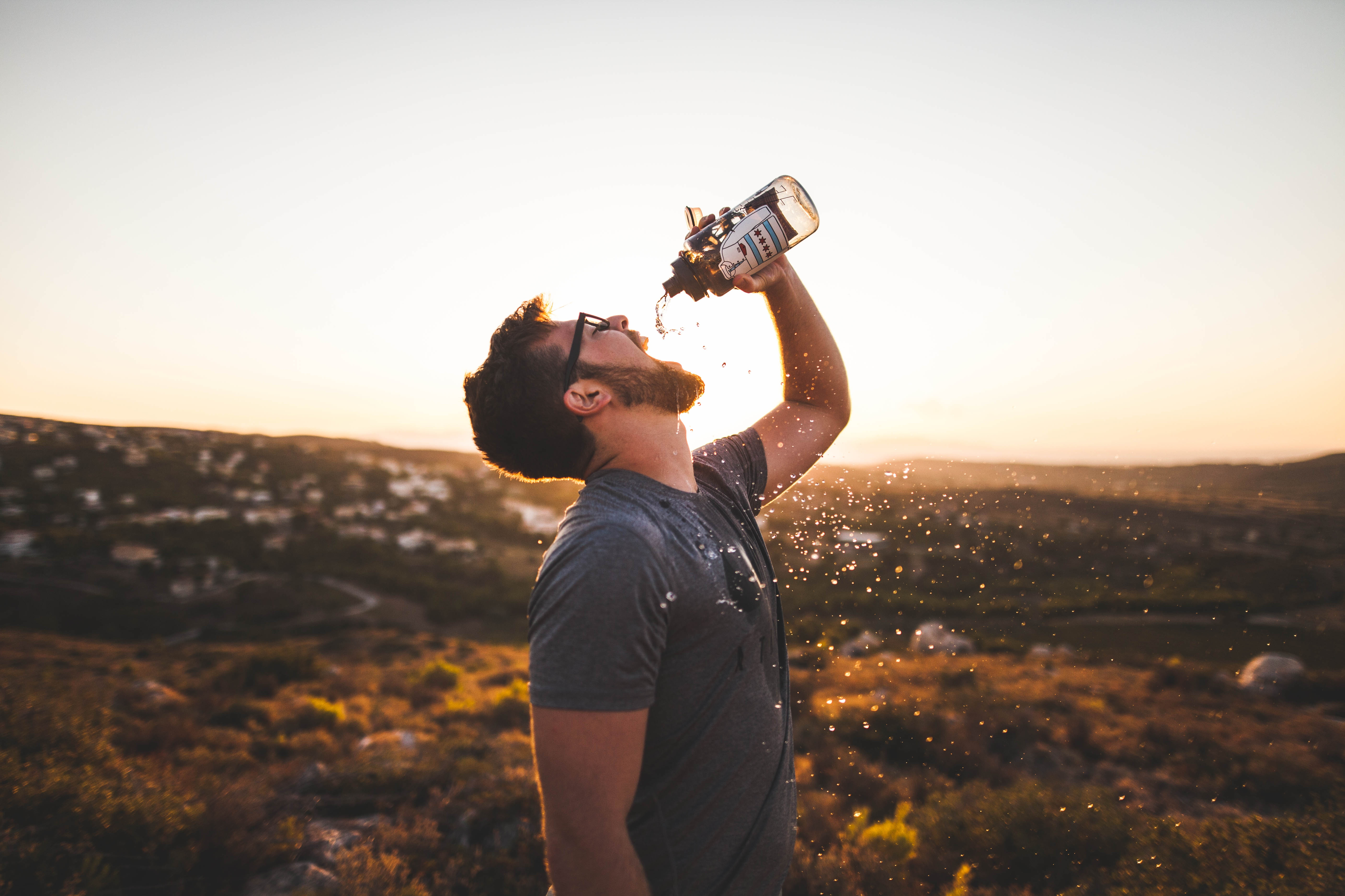 An athlete drinking water to hydrate