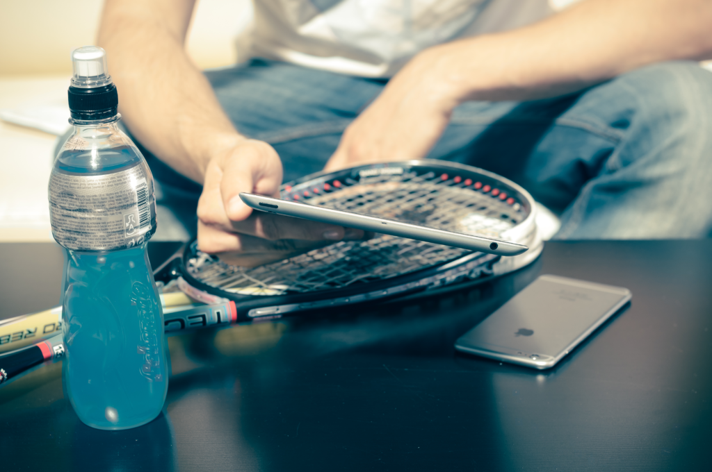 Squash player staying hydrated with sports drink